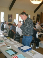 Steve Foster looking at auction items at April meeting